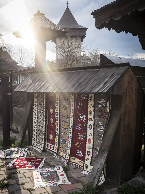 Local sell traditional Bukovina rugs to the few tourists who venture beyond the hills