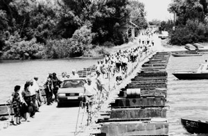 Citizens of the newly-democratised Bulgaria cross infamous  pontoon over the Danube leading to the Belene camp