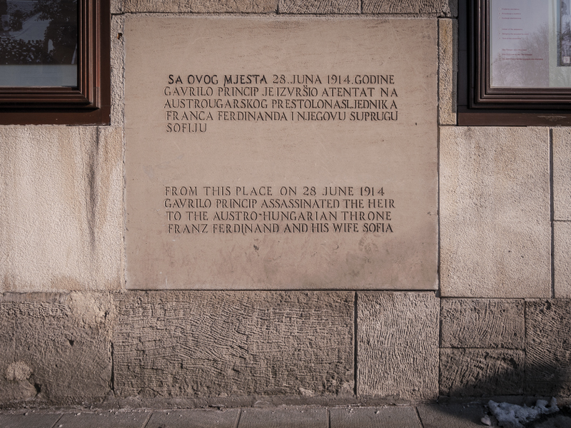 A matter-of-fact plaque on the wall of Schiller's delicatessen where Princip stood when he fired