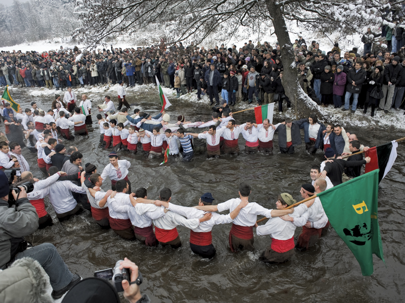MEN DANCING IN ICY RIVER, KALOFER