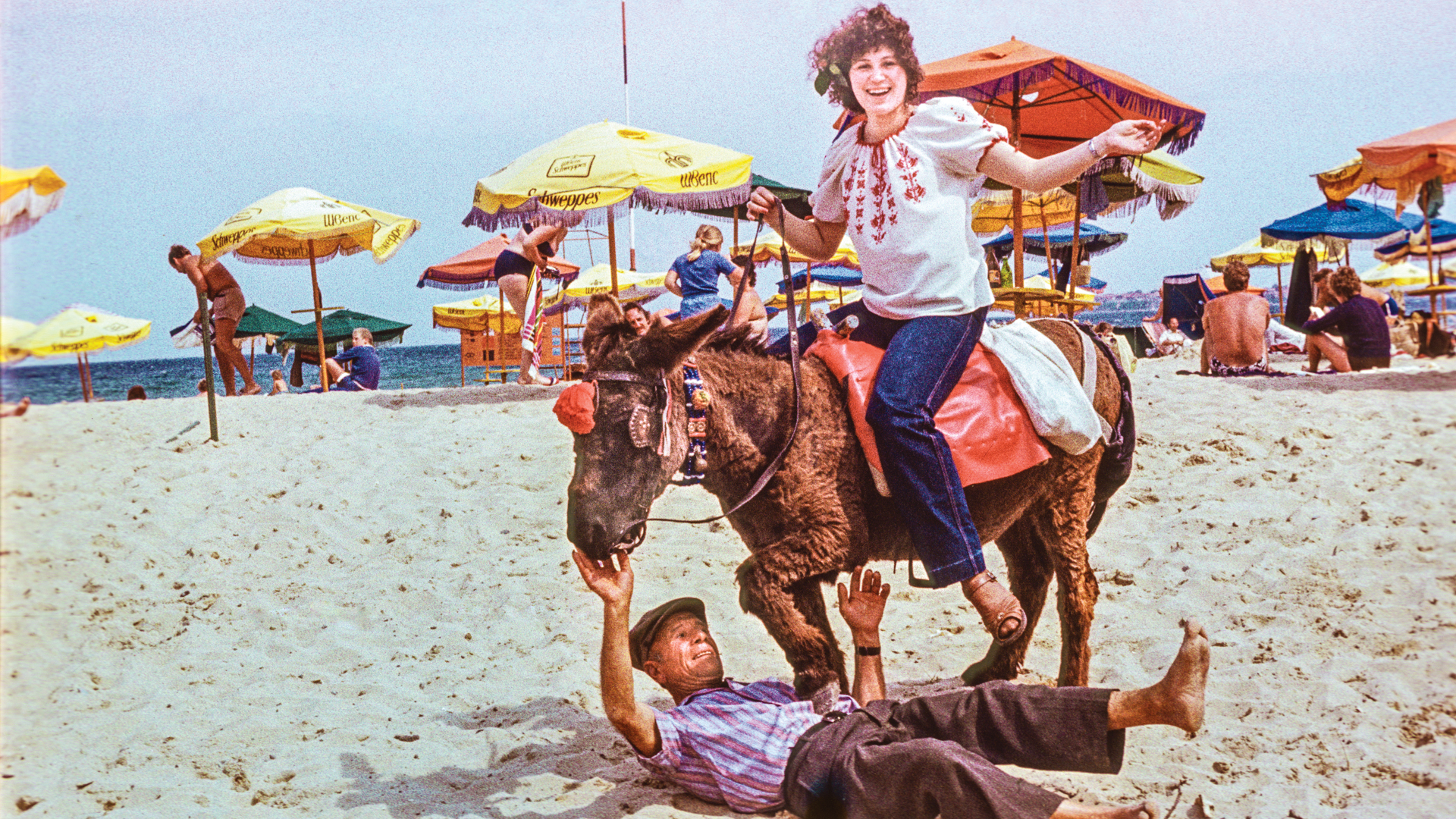 A 1970s tourist attraction: A donkey driver poses with his animal at Sunny Beach