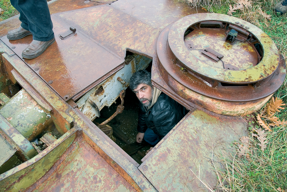 Yambol enthusiast Konstantin Zaykov inspects a relatively well-preserved German Panzer near the village of Fakiya