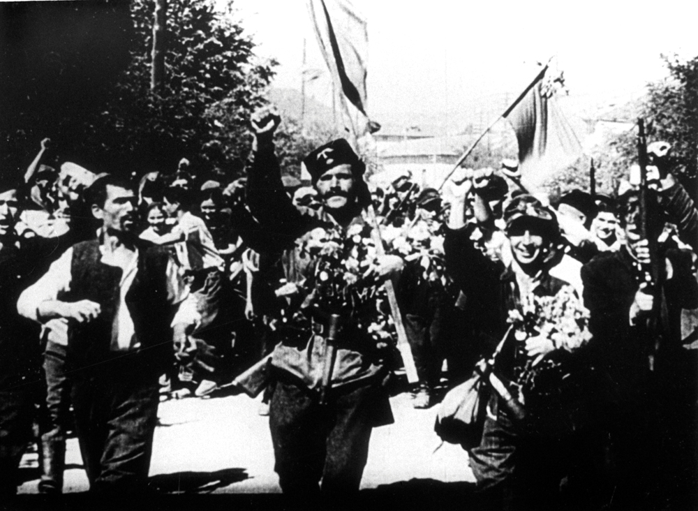 Communist partisans celebrate 9 September 1944. This famous propaganda photo turned out to have been doctored